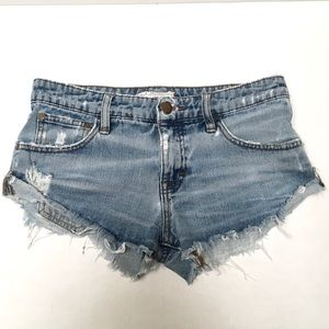 Free People super cheeky distressed cut off shorts